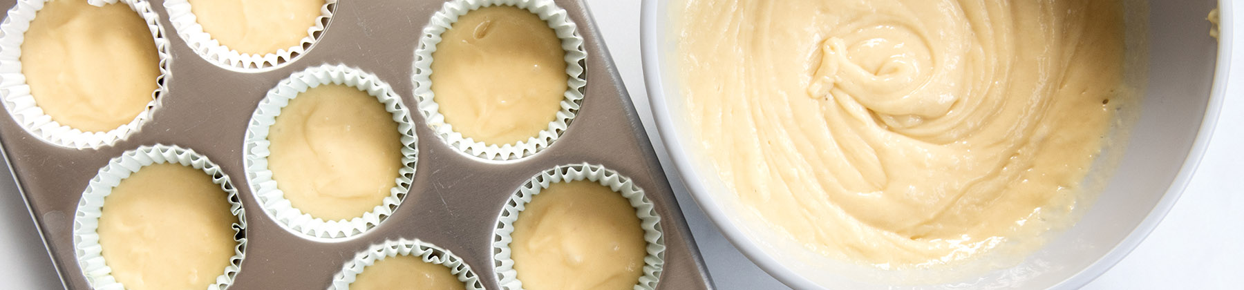 Photo of muffin batter in a muffin pan.