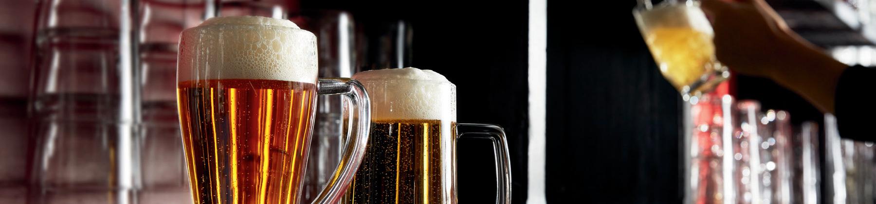 Photo of beer pilsner glasses.