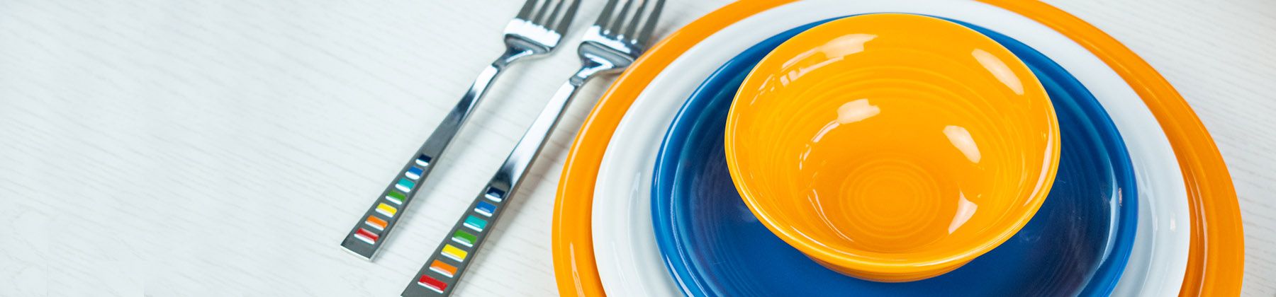 Photo of Fiesta Dinnerware featuring Butterscotch, Lapis, and White.