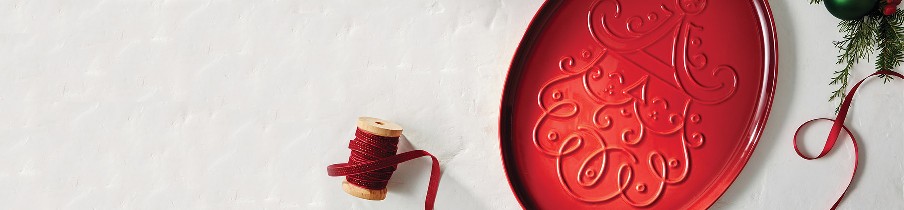 Photo of Le Creuset holiday santa cookie platter.